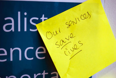 """""""Our services save lives."""" post it note written by a Women's Aid member at National Conference 2015."""